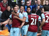 Andy Carroll of West Ham United celebrates with team mates as he scores their first goal during the Barclays Premier League match between Stoke City and West Ham United at Britannia Stadium on March 15, 2014