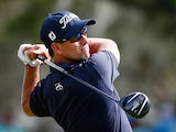 Adam Scott in action on the 12th hole during the final round of the Arnold Palmer Invitational on March 23, 2014