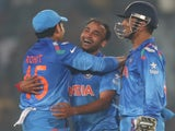 India's Amit Mishra celebrates after dismissing Marlon Samuels of the West Indies during the ICC World Twenty20 Bangladesh 2014 match on March 23, 2014