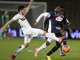 Bordeaux midfielder Andre Poko vies with Nice's forward Neal Maupay during the French L1 football match Bordeaux vs Nice, on March 22, 2014