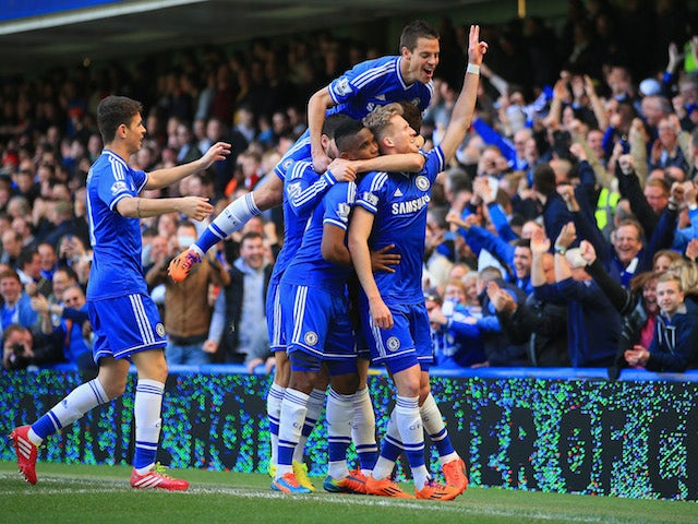 Andre Schurrle of Chelsea celebrates scoring with teammates against Arsenal on March 22, 2014