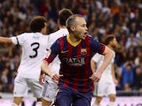 Barcelona's Andres Iniesta celebrates after scoring the opening goal against Real Madrid in the La Liga match on March 23, 2014