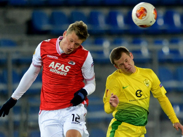 AZ Alkmaar's Viktor Elm vies wih Anzhi Makhachkala's Olexandr Aliyev during UEFA Europa League round of 16 football match between FC Anzhi Makhachkala and AZ Alkmaar in Ramenskoye outside Moscow on March 20, 2014