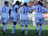 Lyon's Bafetimbi Gomis celebrates with teammates after scoring the opening goal against Guingamp in the Ligue 1 match on March 23, 2014