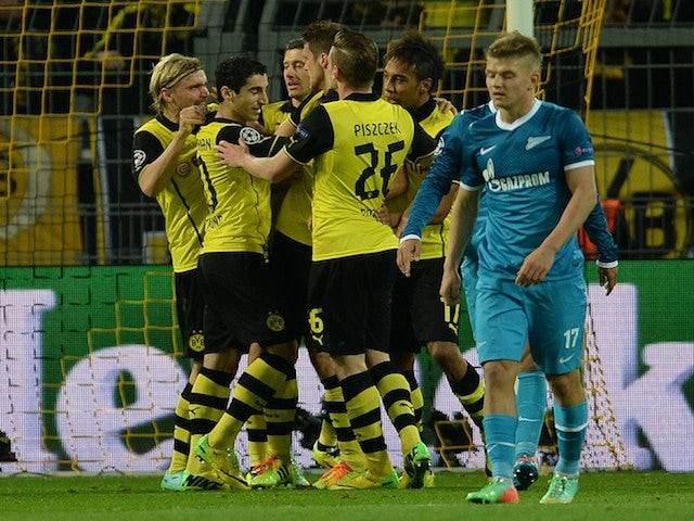 Dortmund�s players celebrate after scoring during the last 16 second-leg UEFA Champions League football match Borussia Dortmund vs Zenit St Petersburg in Dortmund, western Germany on March 19, 2014