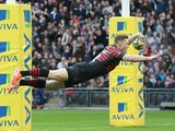 Saracens' Chris Ashton scores a try against Harlequins during the Aviva Premiership match on March 22, 2014
