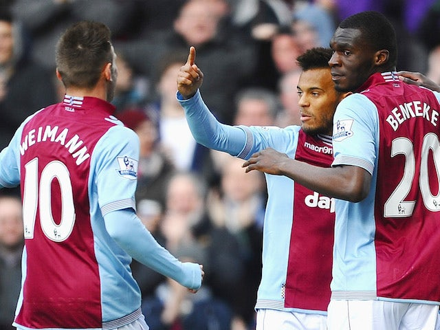 Christian Benteke of Aston Villa celebrates with teammates after scoring the opening goal during the Barclays Premier League match against Stoke City on March 23, 2014