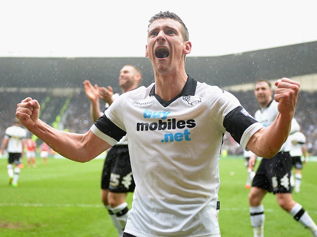 Derby's Craig Bryson celebrates after scoring his third goal against Nottingham Forest during the Championship match on March 22, 2014