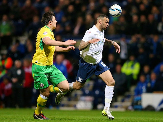 Craig Davies of Preston North End beats Harry Maguire of Sheffield United during the Sky Bet League One match on March 17, 2014
