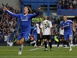 Chelsea's Brazilian player David Luiz (L) celebrates scoring his goal against Manchester City during a Premier League football match at Stamford Bridge in London, England on March 20, 2011