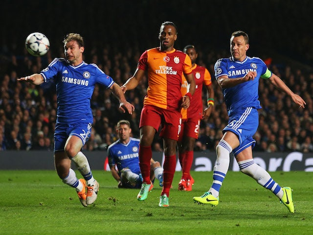 John Terry of Chelsea (R) misses a chance as Branislav Ivanovic of Chelsea (L) and Didier Drogba of Galatasaray (C) look on during the UEFA Champions League Round match on March 18, 2014