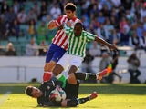 Atletico Madrid's Brazilian forward Diego da Silva Costa (C) vies with goalkeeper Adan and Brazilian defender Paulao (R) during the Spanish league football match