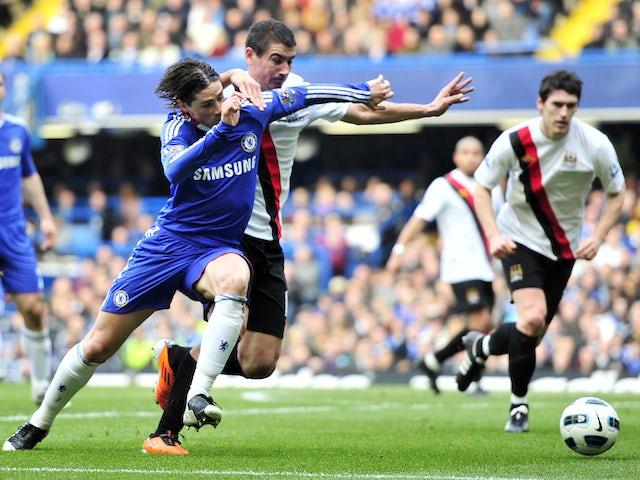 Chelsea's Spanish striker Fernando Torres (L) vies with Manchester City's Serbian defender Aleksandar Kolarov (R) during their English Premier League football match on March 20, 2011