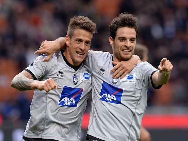 Giacomo Bonaventura (R) of Atalanta BC celebrates his goal with team-mate German Denis during the Serie A match against Inter on March 23, 2014