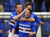Gianluca Sansone (2nd R) of UC Sampdoria celebrates after scoring the opening goal during the Serie A match against Hellas Verona on March 23, 2014
