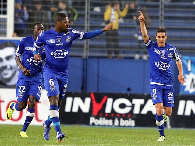 Bastia's Belgian forward Gianni Bruno (R) celebrates after scoring a goal during the French L1 football match between Sporting Club de Bastia (SCB) and Stade de Reims on March 22, 2014