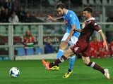 Gonzalo Higuain (L) of SSC Napoli scores the opening goal during the Serie A match between Torino FC and SSC Napoli at Stadio Olimpico di Torino on March 17, 2014