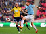Ian Miller of Cambridge United battles with Justin Bennett of Gosport Borough during the FA Carlsberg Trophy Final 2014 at Wembley Stadium on March 23, 2014