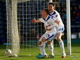 Jamie Allen (L) of Rochdale celebrates with Ian Henderson (R) after scoring the opening goal during the SkyBet League Two match against Wycombe Wanderers on March 22, 2014