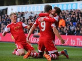 Jay Rodriguez of Southampton is congratulated by Adam Lallana of Southampton after scoring the opening goal during the Barclays Premier League match against Tottenham on March 23, 2014