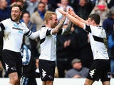 Derby's Johnny Russell celebrates after scoring his team's fourth goal against Nottingham Forest during the Championship match on March 22, 2014