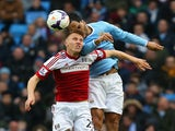 Joleon Lescott of Manchester City and Alexander Kacaniklic of Fulham compete for the header during the Barclays Premier League match on March 22, 2014