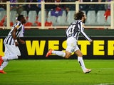 Juventus' midfielder Andrea Pirlo celebrates after scoring a free kick during UEFA Europa League round of 16, second-leg football match Fiorentina vs Juventus at Artemio Franchi stadium in Florence on Marc 20, 2014