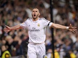 Real's Karim Benzema celebrates after scoring his team's second goal against Barcelona in the La Liga match on March 23, 2014
