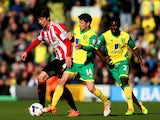 Ki Sung-Yong of Sunderland is challenged by Wesley Hoolahan of Norwich City during the Barclays Premier League match on March 22, 2014