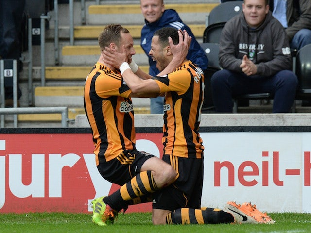 Liam Rosenior of Hull City celebrates scoring the first goal during the Barclays Premier League match against West Bromwich Albion
