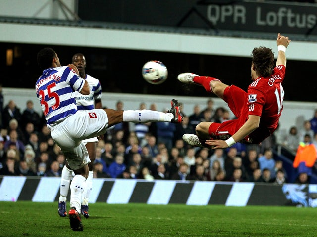 Sebastian Coaytes of Liverpool scores the first goal during the Barclays Premier League match between Queens Park Rangers and Liverpool at Loftus Road on March 21, 2012