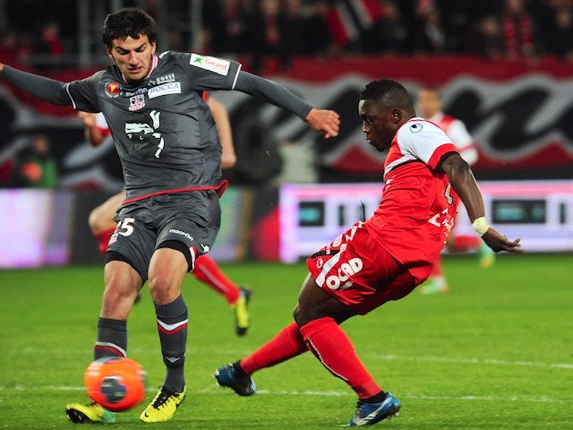 Valenciennes' Majeed Waris scores a goal during the French L1 football match against Ajaccio March 22, 2014