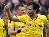 Dortmund's defender Mats Hummels (R) celebrates with his teammates after scoring during the German first division Bundesliga football match against Hannover 96 on March 22, 2014