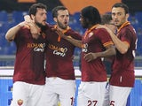 Mattia Destro (L) with his teammates of AS Roma celebrates after scoring the second team's goal during the Serie A match against Udinese on March 17, 2014