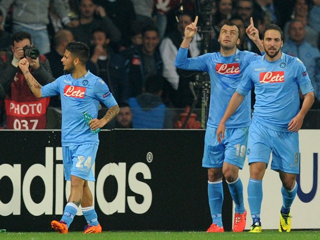 Goran Pandev of SSC Napoli celebrates after scoring the opening goal during the UEFA Europa League Round of 16 second leg match between SSC Napoli and FC Porto at Stadio San Paolo on March 20, 2014