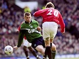 Ole Gunnar Solskjaer, then of Manchester United, scores against Liverpool on March 04, 2000.