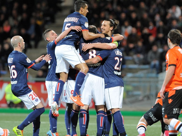Paris Saint-Germain's Italian midfielder Thiago Motta is congratulated by his teammates after scoring during the French L1 football match Lorient (FCL) against Paris Saint-Germain (PSG) on March 21, 2014