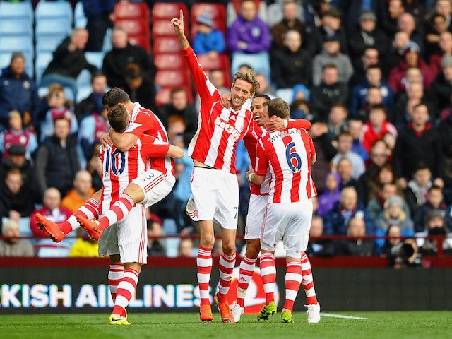 Peter Crouch (C) of Stoke celebrates with teammates after scoring his team's second goal during the Barclays Premier League match against Aston Villa on March 23, 2014