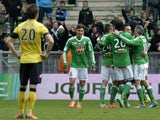 Saint-Etienne's players (R) celebrate after scoring a goal during the French L1 football match AS Saint-Etienne (ASSE) vs FC Sochaux (FCSM) on March 23, 2014