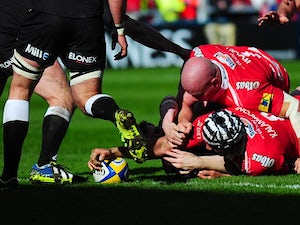 Gloucester's Sione Kalamafoni stretches over to score his team's first try against Newcastle Falcons during the Aviva Premiership match on March 22, 2014