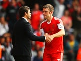 Rickie Lambert of Southampton celebrates with his manager Mauricio Pochettino after scoring during the Barclays Premier League match between Southampton and Crystal Palace at St Mary's Stadium on September 28, 2013