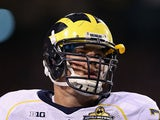 Taylor Lewan #77 of the Michigan Wolverines in action during the Buffalo Wild Wings Bowl against the Kansas State Wildcats at Sun Devil Stadium on December 28, 2013