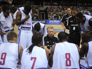 Great Britain coach Joe Prunty talks to the team during a time out during the International Basketball match between Great Britain and Puerto Rico  on August 11, 2013