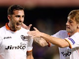 Valencia's forward Paco Alcacer celebrates his goal with Valencia's midfielder Fede Cartabia during the UEFA Europa League Round of 16 football match Valencia CF vs PFC Ludogorets Razgrad at the Mestalla stadium in Valencia on March 20, 2014