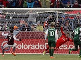 Vicente Sanchez #7 of Colorado Rapids scores on a penalty kick against goalkeeper Andrew Weber in the 73rd minute at Dick's Sporting Goods Park on March 22, 2014
