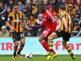 Victor Anichebe of West Bromwich Albion competes with Ahmed Elmohamady and James Chester of Hull City (R) during the Barclays Premier League match on March 22, 2014