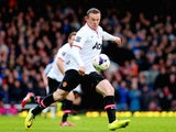 Wayne Rooney of Manchester United scores the opening goal with a long range shot during the Barclays Premier League match between West Ham United and Manchester United at Boleyn Ground on March 22, 2014