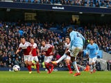 Yaya Toure of Manchester City scores the opening goal from the penalty spot during the Barclays Premier League match against Fulham on March 22, 2014