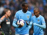 Yaya Toure of Manchester City celebrates scoring their second goal with Fernandinho of Manchester City during the Barclays Premier League match against Fulham on March 22, 2014