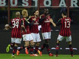AC Milan's forward Mario Balotelli celebrates with teammates after scoring during the Italian Serie A football match AC Milan vs Chievo Verona, on March 29, 2014